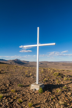 Cross on the mountain in Bolivian Altiplano Stock Photo