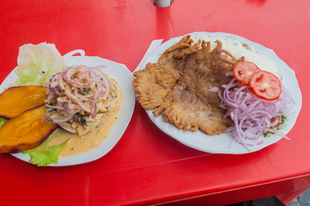 Left: Plate of traditional meal in Peru - ceviche. Right: Fried ray.