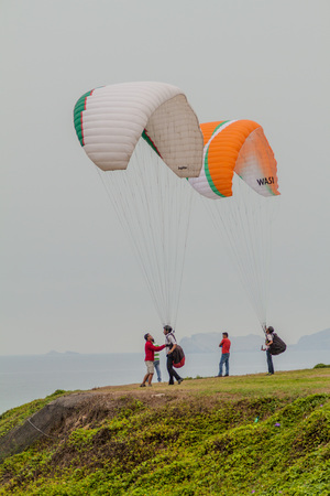 LIMA, PERU - JUNE 4, 2015: Paragliders get ready to fly over cliffs of Miraflores district of Lima Editorial