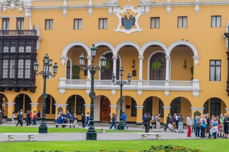 LIMA, PERU - JUNE 4, 2015: Yellow colonial house at Plaza de Armas square in Lima, Peru