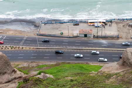 LIMA, PERU - JUNE 4, 2015: Traffic on Circuito de Playas road in Miraflores district of Lima