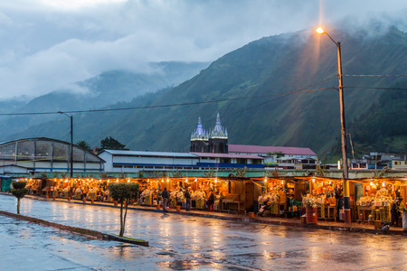 retail scene: BANOS, ECUADOR - JUNE 20, 2015: Food stalls on a market in Banos de Agua Santa, popular tourist destination in Ecuador