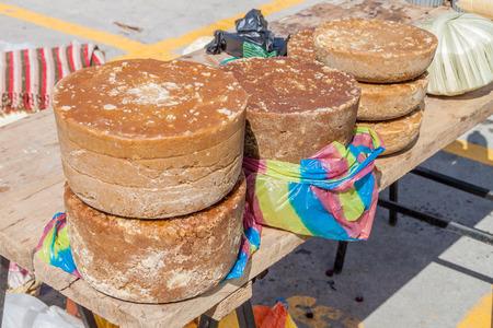 panela: Pieces of panela (unrefined whole cane sugar) at a market in Zumbahua, Ecuador