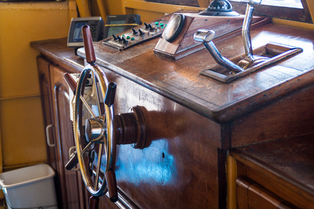 plies: AMAZON, BRAZIL - JUNE 27, 2015: Helm of the boat Anna Karoline II which plies river Amazon between Santarem and Manaus, Brazil.
