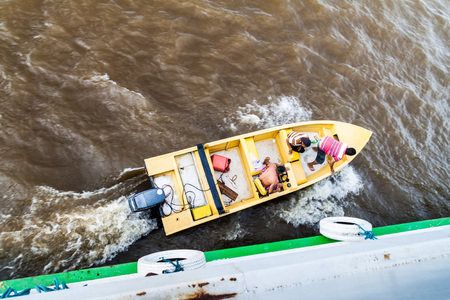 AMAZON, BRAZIL - JUNE 24, 2015: Loading and unloading of goods to the boat Diamante on river Amazon, Brazil.