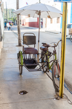 holguin: HOLGUIN, CUBA - JAN 28, 2016: Bici taxi on the street in Holguin, Cuba Editorial