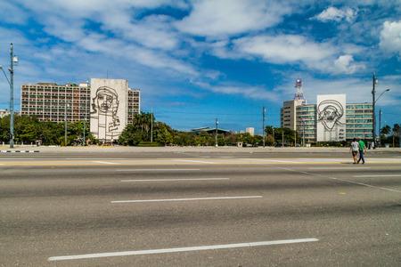 HAVANA, CUBA - FEB 21, 2016: Portrait of Che Guevara on the Ministry of the Interior and Camilo Cienfuegos on the Ministry of Informatics and Communications on Plaza de la Revolucion. Editorial