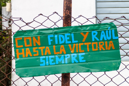 Propaganda in El Cobre village, Cuba. It says: With Fidel and Raul to the victory, always. Stock Photo