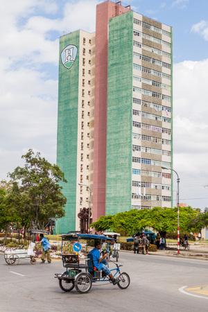 holguin: HOLGUIN,  CUBA - JAN 28, 2016: Tall concrete panel building in Holguin.