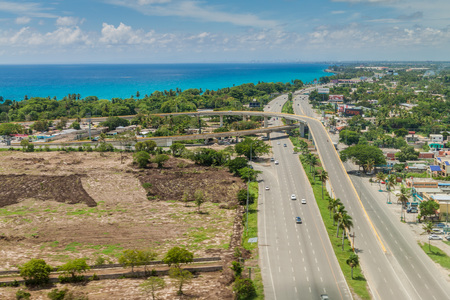 BOCA CHICA, DOMINICAN REPUBLIC - SEP 25, 2015: Aerial view of Boca Chica town in Dominican Republic. Highway 3 and crossing to Las Americas International Airport of Santo Domingo. Editorial