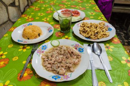 shrimp cocktail: Meal in Baracoa, Cuba. Shrimps, rice, bananas, vegetables and mojito. Stock Photo