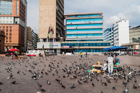 CALI, COLOMBIA - SEPTEMBER 9, 2015: Modern buildings and pigeons in the center of Cali. Editorial