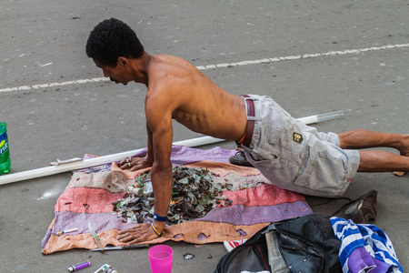 BOGOTA, COLOMBIA - SEPTEMBER 24, 2015: Street performer with shards in downtown of Bogota.