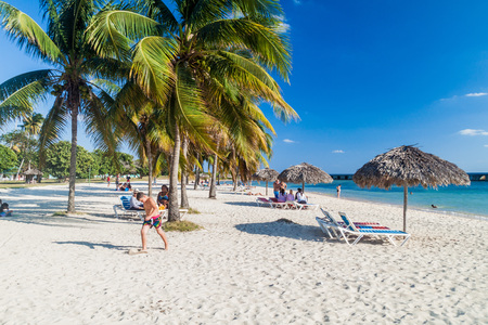 varadero: PLAYA GIRON, CUBA - FEB 14, 2016: Tourists at the beach Playa Giron, Cuba. This beach is famous for its role during the Bay of Pigs invasion. Editorial