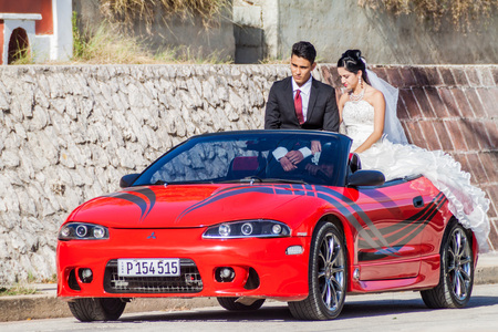 holguin: HOLGUIN, CUBA - JAN 28, 2016: Newly married couple on their ride around the town. Editorial