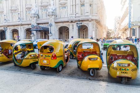 HAVANA, CUBA - FEB 21, 2016: Row of coco taxis in the center of Havana.