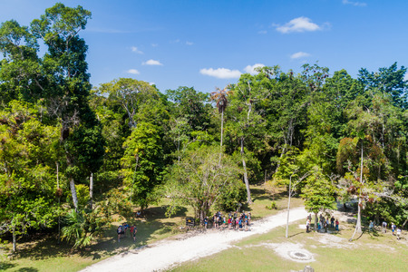 TIKAL, GUATEMALA - MARCH 14, 2016: Tourists visit Complex Q at the archaeological site Tikal, Guatemala