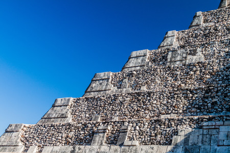 Detail of the steps of the pyramid Kukulkan in the Mayan archeological site Chichen Itza, Mexico