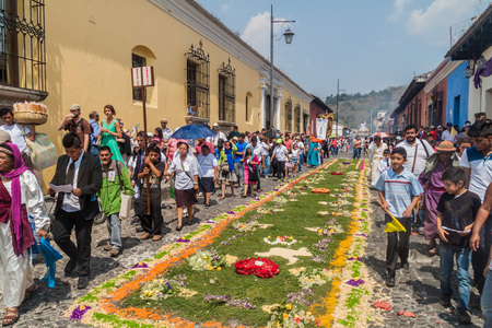 ANTIGUA, GUATEMALA - MARCH 27, 2016: Participants of the procession on Easter Sunday walk along the created carpet in Antigua Guatemala city. Editorial