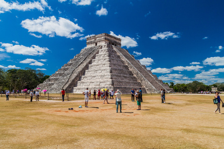 CHICHEN ITZA, MEXICO - FEB 26, 2016: Crowds of tourists visit the Kukulkan pyramid at the archeological site Chichen Itza. Editorial