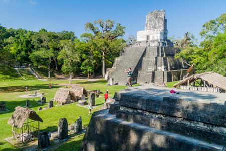 archaeologies: TIKAL, GUATEMALA - MARCH 14, 2016: Tourists visit Grand Plaza at the archaeological site Tikal, Guatemala