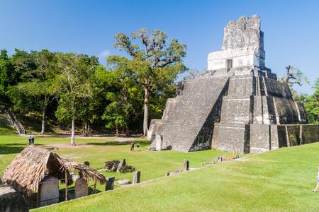archaeological: TIKAL, GUATEMALA - MARCH 14, 2016: Tourists visit Grand Plaza at the archaeological site Tikal, Guatemala