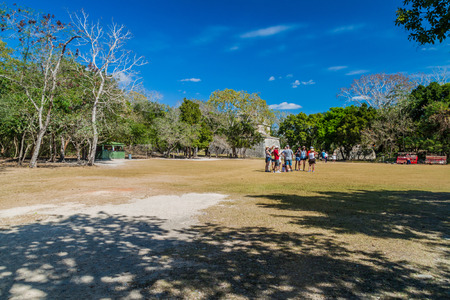 CHICHEN ITZA, MEXICO - FEB 26, 2016: Group of tourists at the archeological site Chichen Itza.