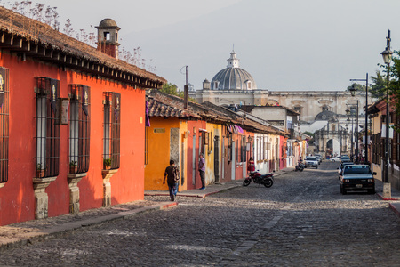 ANTIGUA, GUATEMALA - MARCH 27, 2016: Colorful colonial houses in Antigua, Guatemala