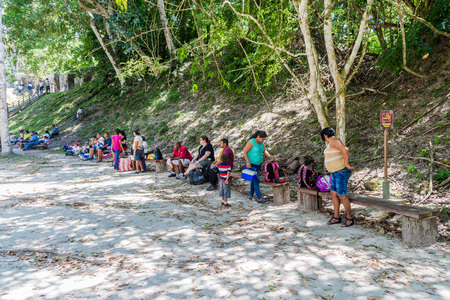 TIKAL, GUATEMALA - MARCH 14, 2016: Tourists rest at the Gran Plaza at the archaeological site Tikal, Guatemala Editorial