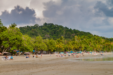 swimm: MANUEL ANTONIO, COSTA RICA - MAY 13, 2016: People on a beach in Manuel Antonio village, Costa Rica
