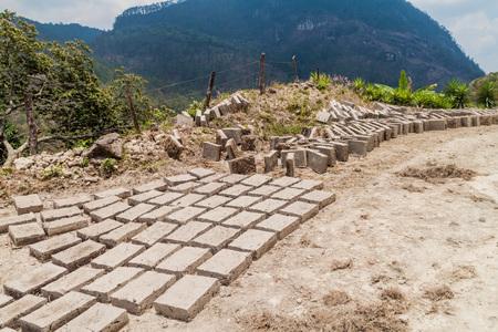 adobe wall: Adobe bricks dry in Belen Gualcho village, Honduras Stock Photo