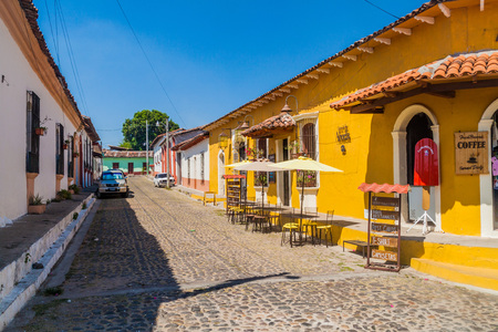 SUCHITOTO, EL SALVADOR - APRIL 9, 2016: Cobbled street in Suchitoto, El Salvador