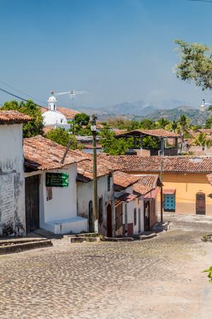 SUCHITOTO, EL SALVADOR - APRIL 9, 2016: Cobbled street in Suchitoto, El Salvador