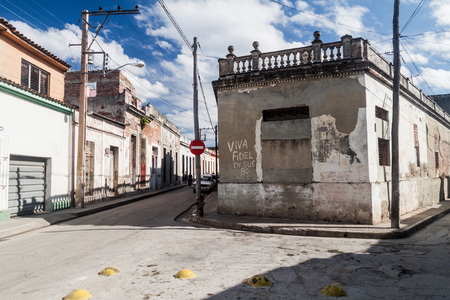 CAMAGUEY, CUBA - JAN 25, 2016: View of a street in Camaguey. The text says: Long live of Fidel at his 88.
