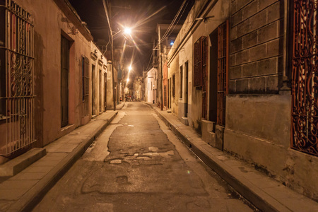 Narrow alley in Camaguey, Cuba Stock Photo