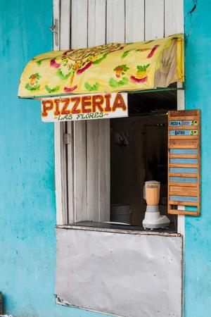 holguin: HOLGUIN,  CUBA - JAN 28, 2016: Stall selling a street food pizza in Holguin