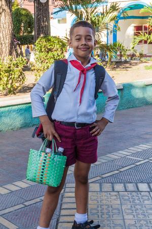 GUANTANAMO, CUBA - FEB 3, 2016: Member of the Young Pioneers organisation poses at Parque Marti in Guantanamo.