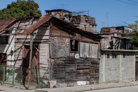 Heavily dilipitated houses in Guantanamo, Cuba Editorial