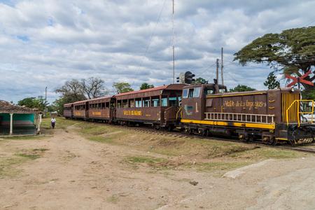 IZNAGA, CUBA - FEB 9, 2016: Local train in Iznaga village in Valle de los Ingenios valley near Trinidad, Cuba