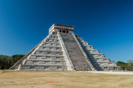CHICHEN ITZA, MEXICO - FEB 26, 2016: Tourists admire the pyramid Kukulkan in the Mayan archeological site Chichen Itza, Mexico Editorial