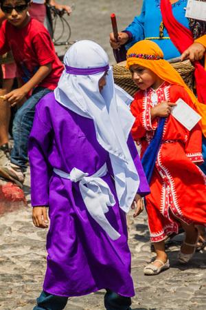 ANTIGUA, GUATEMALA - MARCH 27, 2016: Participants of the procession on Easter Sunday in Antigua Guatemala city.
