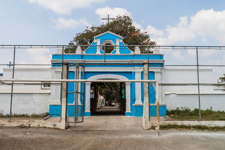 Gate to the cemetery behind the soccer field, Ciudad Vieja, Guatemala Stock Photo