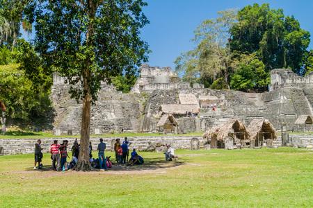 TIKAL, GUATEMALA - MARCH 14, 2016: Tourists at the Gran Plaza at the archaeological site Tikal, Guatemala Editorial