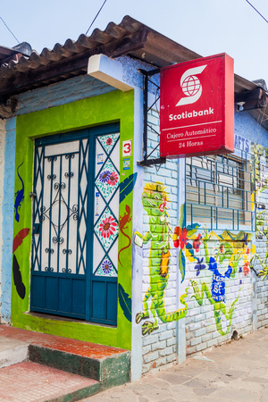 CONCEPCION DE ATACO, EL SALVADOR - APRIL 3, 2016: Colorfuly painted bank building in Concepcion de Ataco village.