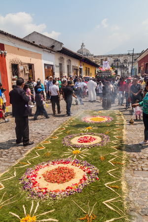 ANTIGUA, GUATEMALA - MARCH 27, 2016: Decorated carpet on the street before the procession on Easter Sunday in Antigua Guatemala city.