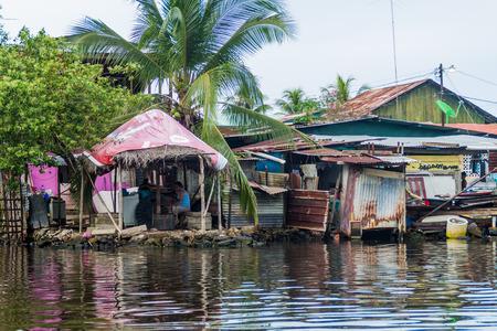 ALMIRANTE, PANAMA - MAY 19, 2016: Seaside houses in Almirante village, Panama