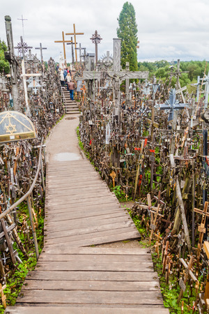 devotee: SIAULIAI, LITHUANIA - AUGUST 18, 2016: The Hill of Crosses, pilgrimage site in northern Lithuania