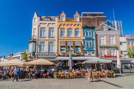 DEN BOSCH, NETHERLANDS - AUGUST 30, 2016: Historic houses and open air restaurants in Den Bosch, Netherlands
