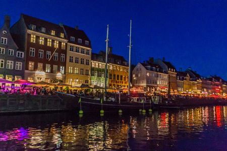 danish: COPENHAGEN, DENMARK - AUGUST 27, 2016: Evening panorama of Nyhavn district architecture in the Old Town of Copenhagen, Denmark