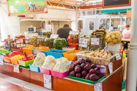 RIGA, LATVIA - AUGUST 19, 2016: Food stall at Riga Central market, Latvia Editorial